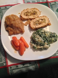 Clockwise from top left: Caramelized onion mashed potatoes, Gardein Holiday Roast, creamed spinach, and glazed carrots